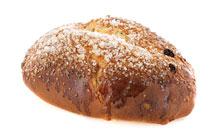Eindejaarsbrood met rozijnen, suiker en marsepein